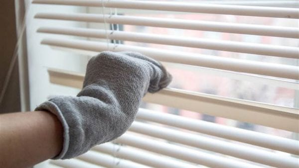 Wipe away dust from blinds